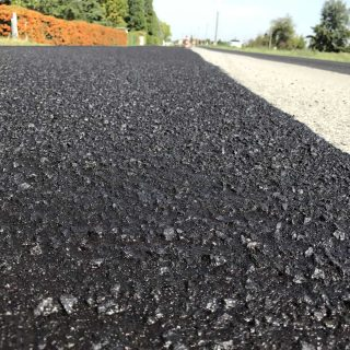 Road surface dressing via micro-surface paving - Slurry Srl