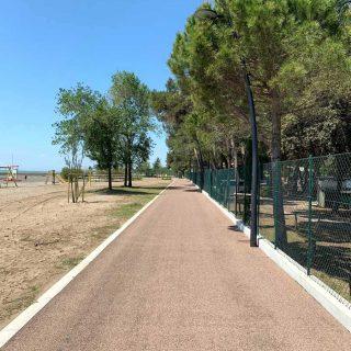 Grado - triple layer green asphalt cycle path - Slurry Srl